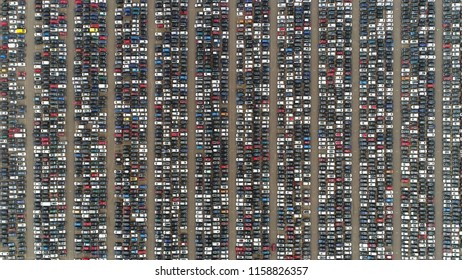 Aerial top down photo automaker car lot showing vehicles parked close to each other ready for further distribution the automotive industry is one of worlds most important economic sectors by revenue