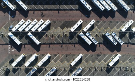 Aerial top down photo of bus terminus is designated place where bus or coach starts or ends its scheduled route termini can be located at bus stations interchanges garages or bus stops
