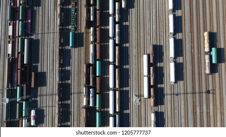 Aerial top down photo of classification yard is railroad infrastructure found at freight train stations used to separate railway cars onto one of several tracks