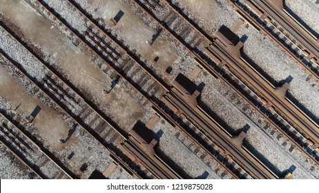 Aerial top down photo of classification yard railway track is railroad gathering found at some freight train stations used to separate rail cars onto one of several tracks