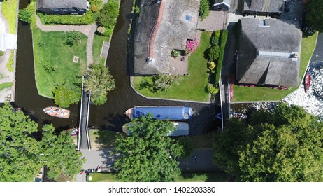 Aerial top down photo of Giethoorn is a Dutch town in the province of Overijssel the Netherlands and is located in the municipality of Steenwijkerland and is often referred to as Little Venice