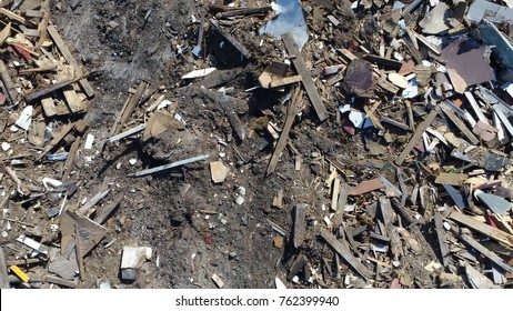 Aerial top down photo landfill site also known as tip dump rubbish dump garbage dump or dumping ground site for disposal of waste materials by burial and oldest form of waste treatment