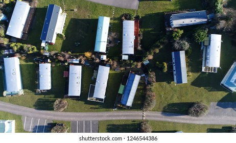 Aerial top down photo of mobile homes partlty used as permanent houses but also for holiday or temporary accommodation they are left often permanently or semi-permanently in one place but can be moved