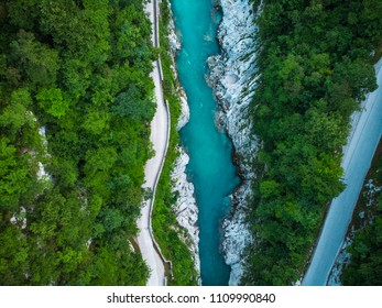 Aerial top down photo of road and Soca river in Slovenia.