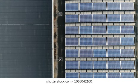 Aerial top down photo of solar panels PV modules mounted on onse side of flat roof photovoltaic solar panels absorb sunlight as a source of energy to generate electricity creating sustainable energy