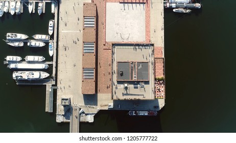 Aerial top down photo tall building roof in Belgium Antwerp located along the river Scheldt in Eilandje district showing people enjoying the beautiful weather of summer day