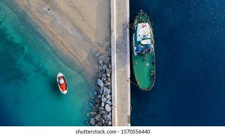 Aerial top down photo of traditional fishing boat in small beach near old port of Mykonos island, Cyclades, Greece