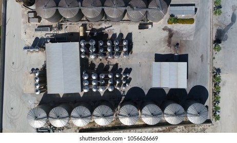 Aerial top down photo of wine producing factory and wine orchard winemaking is production of wine starting with selection of the fruit its fermentation into alcohol and bottling of finished liquid