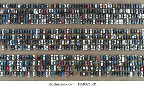 Aerial top down picture of automaker car lot showing vehicles parked close to each other ready for further distribution