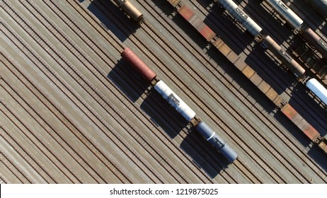 Aerial top down picture of classification yard with goods wagons on the railroad gathering found at some freight train stations used to separate rail cars onto one of several tracks
