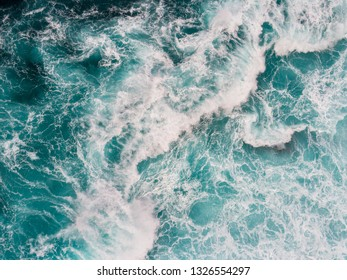 Aerial top down shot of ocean or sea surf during the storm