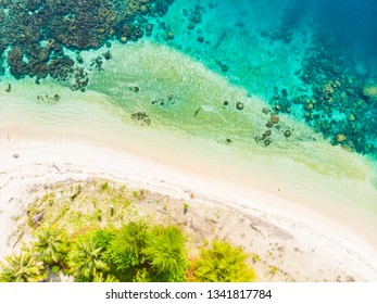 Aerial top down view Banyak Islands Sumatra tropical archipelago Indonesia, Aceh, coral reef white sand beach. Top travel tourist destination, best diving snorkeling.