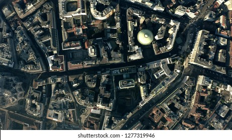 Aerial top down view of the city streets and houses pattern in the centre of Milan, Italy