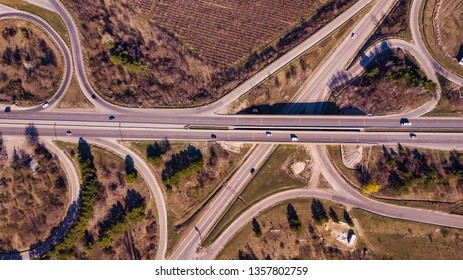 Aerial top down view of interchange road junction traffic.