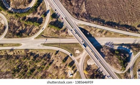Aerial top down view of interchange road junction traffic.