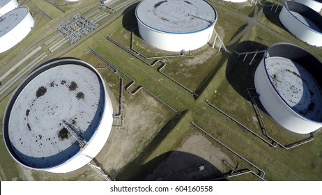 Aerial top down view of oil depot sometimes called tank farm or oil terminal is industrial facility for storage of oil and petrochemical products ready for transport to further storage facilities