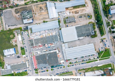 aerial top down view on roofs of industrial building. industrial zone on city suburb