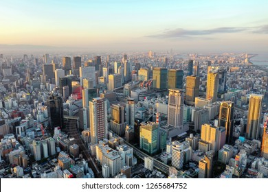 Aerial top down view over Osaka city Japan with many roads and high building and railway.