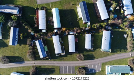 Aerial top down view photo of Farm Campsite and Holiday Park moving left over site showing the long-term campsite that includes permanent and semi-permanent setups and parking spaces