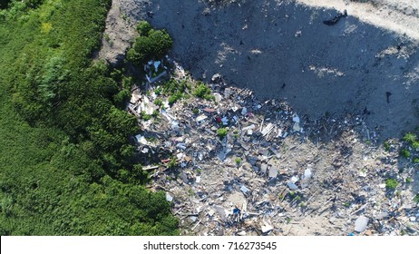 Aerial top down view photo of garbage recycling yard and green vegetation at side of garbage in urban areas garbage is collected and treated as municipal solid waste