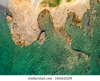 Aerial top down view of the rock formation at the coastal village Kitries, located near Kardamili about half an hour from Kalamata city, Messenia. Amazing summer scenery in the Messenian Gulf, Greece