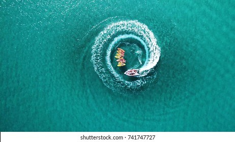 Aerial top down view of slalom made by speed boat on a Kayak sailing instruction