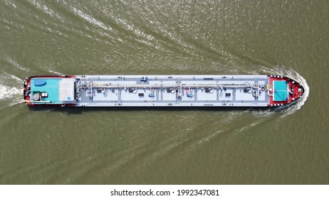 Aerial top down view of tank barge is vessel that is used to carry liquids solids and gas through waterways and rivers and across areas of ocean an essential player in energy and offshore industries
