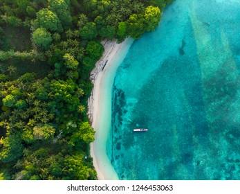 Aerial top down view tropical paradise pristine beach rainforest blue lagoon at Banda Island, Pulau Ay. Indonesia Moluccas archipelago, top travel destination, best diving snorkeling.