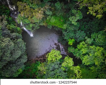 An aerial top down view of the Twin Falls waterfall on the Road to Hana in East Maui, Hawaii. This waterfall is a popular swimming destination for travelers.