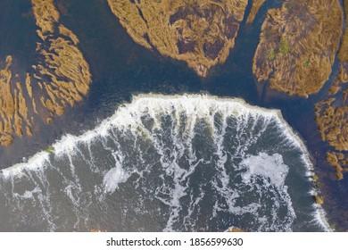 Aerial top down view of Venta Rapid (Ventas Rumba) waterfall. Widest waterfall in Europe located in Kuldiga