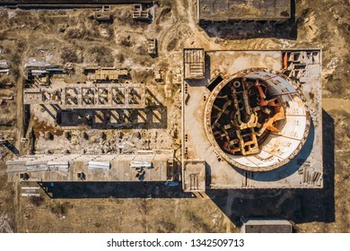 Aerial top view of abandoned and ruined Nuclear Power Plant in Shelkino, Crimea. Large USSR industrial construction with round tower of atomic reactor, drone shot