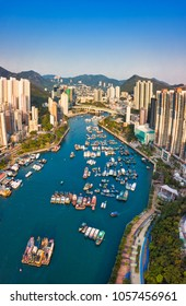 Aerial Top View of The Aberdeen Bay and Skyscrapers on two sides of the harbour in Southern District,Hong Kong.