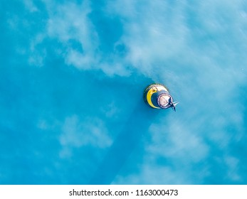 aerial top view from above sea buoy isolated in a water wave surface safety concept with copy space design
