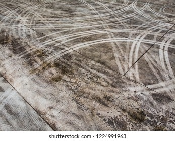 Aerial top view background with tire marks on cement floor, texture of tire marks.