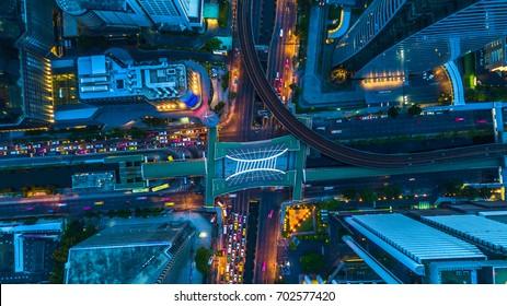 Aerial top view of Bangkok city skycraper at night, Bangkok, Thailand.