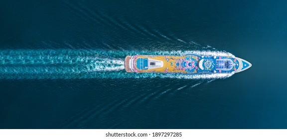 Aerial top view of beautiful white cruise running with contrail in the ocean sea,  luxury cruise in the ocean sea concept tourism relax and travel on  holiday vacation time.