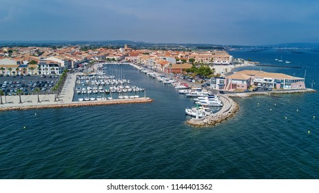 Aerial top view of boats and yachts in marina from above, harbor of Meze town, South France