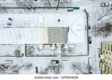 aerial top view of building roof under renovation in winter. residential area. drone photography