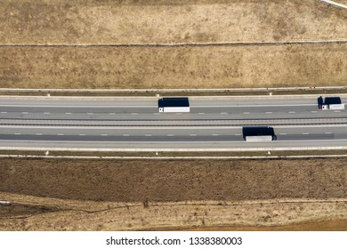 Aerial top view of cars and trucks passing on a highway, drone shot