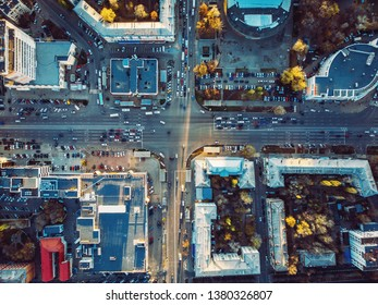 Aerial top view of city asphalt roads with lot of vehicles or car traffic and buildings, modern urban intersections and junctions in midtown, toned