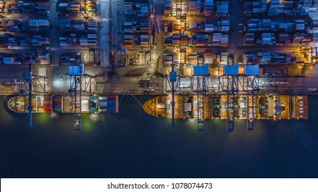 Aerial top view container cargo ship working at night, Business import export logistic and transportation of International by ship in the open sea.
