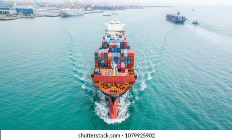 Aerial top view container cargo ship, Business import export logistic and transportation of International by container cargo ship in the open sea.