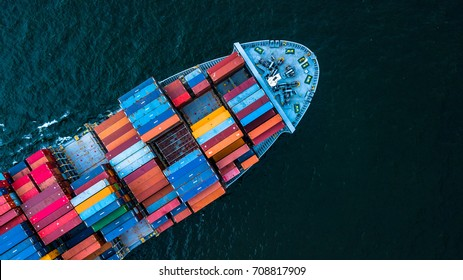 Aerial top view container cargo ship in import export business logistic and transportation of international by container ship in the open sea, with copy space.