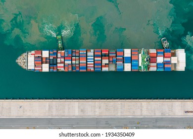 Aerial top view Of Containers cargo ship. Business logistic transportation sea freight, Cargo ship, Cargo container in deep sea port at industrial estate for import export around in the world