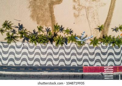 Aerial top view of Copacabana Beach sidewalk with palms, Rio De Janeiro, Brazil
