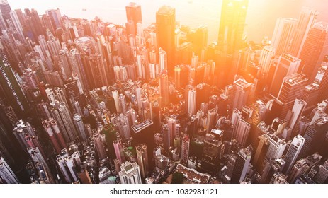 Aerial top view of developed Metropolis city with tall office skyscrapers in downtown district with blocks. Big megapolis cityscape with advanced urbanisation and infrastructure. Real estate business