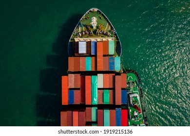 Aerial top view from drone, Container ship or cargo shipping business logistic import and export freight transportation by container ship in open sea,