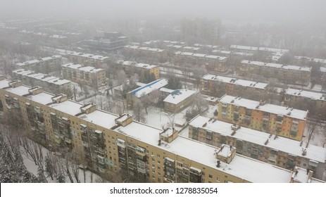 Aerial top view from drone on city rooftops patio. Winter season snow (Dnepr, Dnepropetrovsk, Dnipropetrovsk). Ukraine