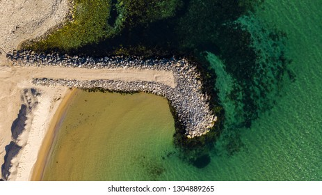 Aerial top view from drone to stone sea coast and old pier in Nessebar, Bulgaria