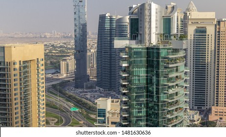 Aerial top view of Dubai Marina and JLT evening timelapse. Skyscrapers before sunset in Dubai, UAE. Modern towers and traffic on the road